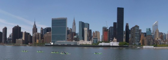 HarborLAB paddling past the skyline in a panorama by Manny Steier.