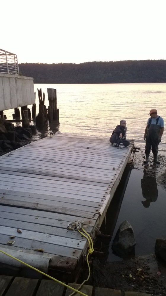 HarborLAB's dock at its current Yonkers Paddling and Rowing Club home. HarborLAB Facilities Manager Patricia Erickson seated, YRPC Commodore John Maggiotto in waders.