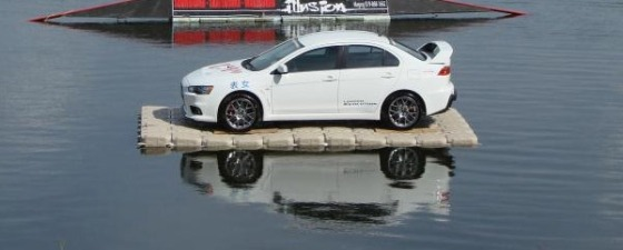 Candock floating a car. Yeah, it can handle our kayaks.  :)