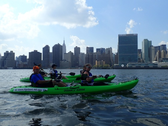 Hunters Point Community Middle School science teacher Bart Piscitello and colleagues enjoy the open East River.
