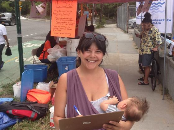 A neighborhood mom signs HarborLAB's CSO petition.